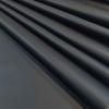 Karia fekete műbőr hullámos oldalt3
